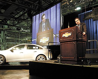 BIG ANNOUNCEMENT: Mark Reuss, president of General Motors North America, announces a third shift will be added at GM's Lordstown complex. Added production is needed for the Chevrolet Cruze, one of which is seen to his side.