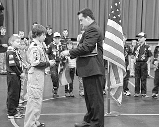 Special to The Vindicator PRESENTATION: Catholic Schools Week was celebrated at St. Paul School in Salem with a series of special events and programs shared by the students and their families. During a program on Feb. 2, Craig Brown, Columbiana County recorder, presented an Ohio state flag to the school. Accepting the flag on behalf of the student body was Lex Murray.