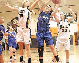 GIRLS BBALL - (14) Katie Snoddy fights for the ball with (30) Ruth Prosko and (32) Hillary Hoppel during their game Thursday night in Mineral Ridge. - Special to The Vindicator/Nick Mays