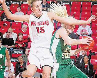 COLLISION COURSE: YSU's Rachael Manuel (15) collides with Wright State's Erica Richardson (25) during a rebounding attempt during the second half of Thursday's game at Beeghly Center. The Penguins lost 57-38.