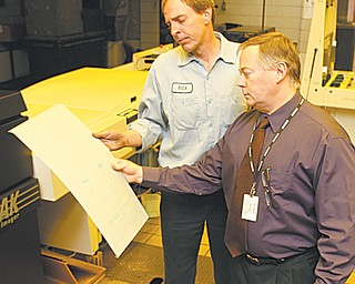 Rick Wineman, pressroom foreman, left, and Jim Davies, production