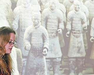 William D. LEwis/ The Vindicator Rochelle Beiersdorfer tallks about Terracotta Warriors during a Saturday event at YSU about China. Her father YSU Prof Ray Beiersdorfer recently led a group of YSU students  on a trip to China.