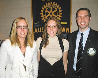 The Rotary Club of Austintown recently sponsored its annual 4-Way Speech Contest. Those participating were instructed to take the principles of Rotary's 4-Way Test and apply them to their own experiences. Aseel Ramahi, center, won the contest with her concept of a person with the ability to live in peace within two cultures despite cultural differences. Joining the Fitch High School senior, who will continue the competition at the district level in North Canton on March 20, are, from left, Rachel Solida, Rotary vocational chair, and Brian Laraway, club president.
