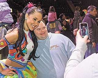 """Phillip Lalama of Boardman smiles as he gets his photograph taken with a circus performer. The audience interacted with performers before the Ringling Bros. and Barnum & Bailey's """"Zing Zang Zoom"""" Circus at the Covelli Centre on Thursday night. The circus continues there through Sunday night."""