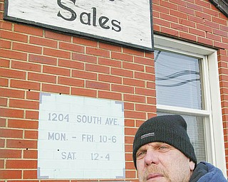 At Denny's Auto Sales, 1204 South Ave., protecting the inventory is essential  to staying in business in the neighborhood. Bob Kover is one of the salesmen at the dealership.