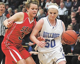 POLAND - SALEM - (50) Leanna Yeager of Poland drives to the hoop as (35) Amy Scullion plays defense during their game Thursday night in Austintown.