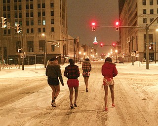 Headed towards a downtown nightspot on Central Square are, from left, Ebony Franklin, Deedee Dunne, Charmaine Payne and Asia Howell, all of Youngstown.