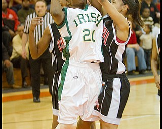 Geoffrey Hauschild The Vindicator.Ursuline's Jasmine Brown (20) takes aim at the hoop wile defended by Campbell's Tashira Uceta (1) during the second quarter at Mineral Ridge High School on Saturday afternoon.