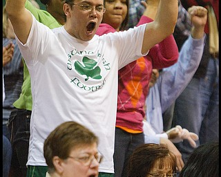 Geoffrey Hauschild The Vindicator.Arvin Irizarry Sr., of Youngstown, cheers as his daughter Aurielle plays with her fellow Ursuline teamates during the fourth quarter at Mineral Ridge High School on Saturday afternoon.