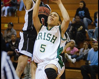 Geoffrey Hauschild The Vindicator.Ursuline's Aurielle Irizarry (5) tries for a layup but is ultimately fouled byCampbell's Tashira Uceta (1)  during the fourth quarter at Mineral Ridge High School on Saturday afternoon.