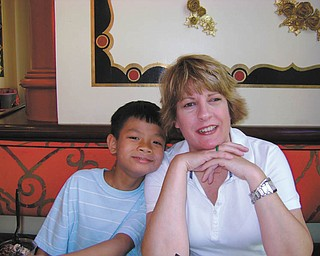 Christion Bi is Mary ComptonÕs adopted son from Vietnam. They live in Poland..