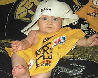 Lanie Rose Joyce of Boardman is posing for some Steelers photos before last yearÕs Super Bowl..