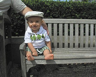 Jack Hurdley of New Middletown is enjoying the sun on vacation on his own ÒminiÓ park bench. Sent by his mother, Jessica Hurdley..