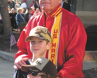 Jackie LeViseur sent this picture of her nephews, Brady and Casey Leugers of Canfield, and her dad, Ed LeViseur, at the reading of the names on Veterans Day in downtown Youngstown..