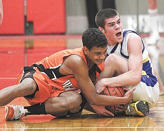(1) Justin Rota of McDonald and DeShon Pullie battle for the ball during their game Monday night in Struthers.