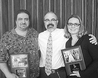 Special to The Vindicator Two employees of Iron and String Life Enhancement were recognized for their unstinting work with adults and children with disabilities during an annual Employee of the Year luncheon in January. Jimmy Sutman, president of ISLE, center, congratulates the honorees, Mike Lucas and Kelly Buhro as they display their service awards.