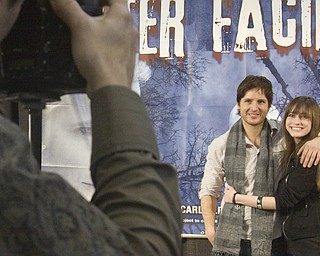 Marissa McIntyre (21) of Warren poses with Twilight star Peter Facinelli at Eastwood Mall in Niles, while local photographer Michael Stephen shoots.