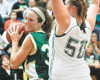 Ursuline's Chase Connors (33) gets blocked by Smithville's Cortney Breeze (50)