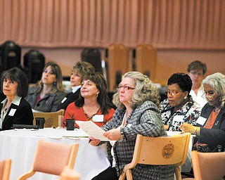 A group of women listen to Edward Hopson, senior partner of Real Estate Capital Partners, speak at Youngstown State University. He was one of the speakers Thursday at the third annual Minority & Female Business Conference.