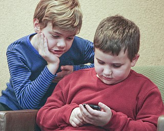 ROBERT K. YOSAY | THE VINDICATOR..techno guru's - as Mathew Rossi 8 of Poland and Santino Angelilli 7 of Struthers ck their hand held computer to help them figure out spellings of the words  in the 2010 -77th Vindicator Spelling Bee was held  at the Chestnut Room at Kilcawley Center at YSU - 30-