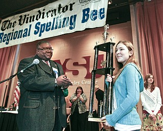 ROBERT K. YOSAY | THE VINDICATOR..congratulating the champion and presenting the trophy  Rev. Lewis Macklin applauds Champion - Springfield Elementary Julia Miglets -  as the winners in the 2010 -77th Vindicator Spelling Bee was held  at the Chestnut Room at Kilcawley Center at YSU - 30-