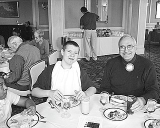 The Vindicator  Students from Harding Elementary School on Youngstown's North Side were guests of the Youngstown Rotary Club at a March 3 luncheon at the Youngstown Club. Among those enjoying the fellowship while participating in the event are, from left, Timothy Lipscomb, a Harding student, and Rotarian Roy Passarelli. Club members serve as mentors to the Harding students, helping with school work and teaching them how to follow their dreams and become productive adults.