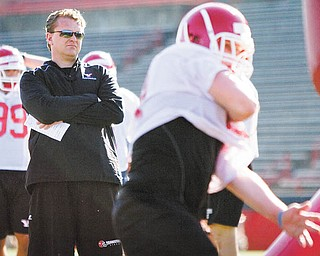 In his first spring practice as YSU's head football coach, Eric Wolford watches his players during drills Wednesday afternoon at Stambaugh Stadium.