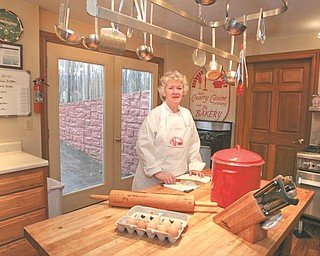 Ellen Conrad stands in the kitchen of her home in Salem. She runs a cooking school and teaches the entire spectrum of dining delights.