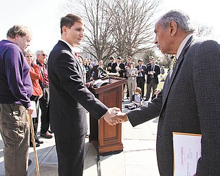 Rep. John Conyers, D-Mich., right, thanks Rep. John Boccieri, D-Ohio, for his support of the health care reform bill on Friday, March 19, 2010 on Capitol Hill in Washington. (AP Photo/Lauren Victoria Burke)