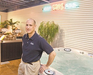 LISA-ANN ISHIHARA | THE VINDICATOR --- Andy Shobel stands in the spa section at the lower level at The Great Escape located at 7373 Market Street in Boardman.