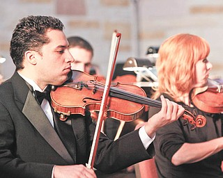 Alejandro Kamayd of Akron plays violin on stage at Christ Episcopal Church in Warren for the Warren Philharmonic Orchestra during a performance on Sunday, November 22, 2009.