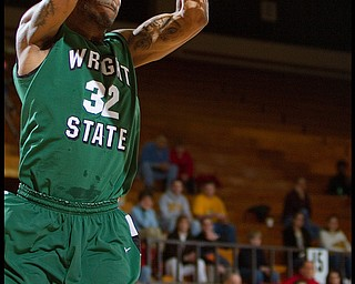 The Vindicator/Geoffrey Hauschild2.25.2010Wright State's Todd Brown (32) makes a slam dunk while Youngstown State University's Vance Cooksey looks on helplessly during the second half at YSU's Beeghley Center on Thursday evening. Wright State went on to defeat YSU 76 - 73.