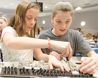 Liberty sixth-graders Isabella Nunu, 12, left, and Courtney Weimer, 11, take apart a computer keyboard during Tear Apart a Toaster Thursday at Youngstown State University's Moser Hall. YSU's Society of Women Engineers arranged the event.