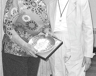 The Vindicator: During the March 11 meeting of Hubbard Historical Society, a Wendell August Forge commemorative plate was presented to, at left, Cecilia Cooper, society president, in recognition of her work and dedicated service to the organization. Sharing the moment with the honoree is Tess Hickey, who made the presentation.