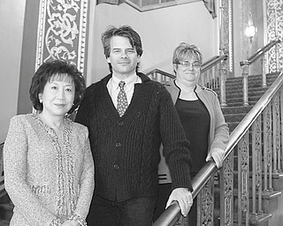 Robert K. Yosay   The Vindicator: Looking forward to a gala evening of fine food, fine wines and fine entertainment during the Stargazer Ball to be presented by Youngstown Symphony Guild are, from left, Florence Wang, event chairwoman; Randall Craig Fleischer, orchestra conductor; and Mercy Komar, guild president.