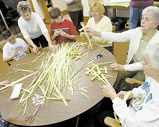 Volunteers, from left to right, Nicholas Workman, Fran Heinl,  Adam Raub, Terri Raub, Kathy Finley and Twila Robb, make palm crosses at Zion Lutheran Church in New Middletown, Thursday evening on March 25, 2010.