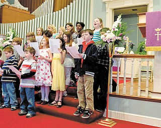 """The Calvary Youth Choir sings """"We Were Made to Praise You"""" at Calvary Baptist Church Sunday to kick off the church's Easter Cantata."""