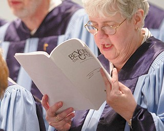 """Nancy Sejpner performs as part of the Adult Chancel Choir at Calvary Baptist Church in Boardman. The choir sang """"Beyond the Cross,"""" by Robert Sterling for the church's Easter Cantata on Sunday evening."""