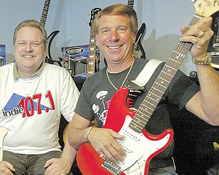 Frank Fordeley, right, owner of Fordeley's Music and Nunnies Motors in Champion and Gregg Allen pose at Fordeley's Music.