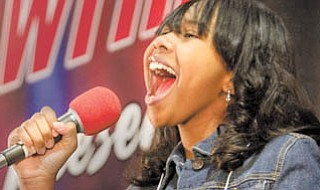"""Geoffrey Hauschild The Vindicator.Gariana Bercheni, 12 of Warren, performs during a local casting call for NBC's """"America's Got Talent"""" television show at Eastwood Mall in Niles on Sunday afternoon. Over 130 participants competed in the event sponsored by WFMJ Channel 21."""