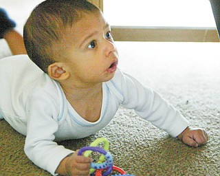 Caleb is on the verge of crawling.