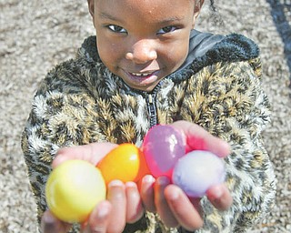 Esther Gitimu shows off the handful of Easter eggs she collected at an Easter egg hunt Tuesday sponsored by the Boardman Kiwanis for kindergarten students at Boardman schools.