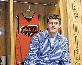 Dallas Blocker sits in the men's basketball locker room at YSU's Beeghly Center on Tuesday after a press conference announcing that he had received the Comeback Player Award by The V Foundation for Cancer Research. Blocker was diagnosed with testicular cancer in Spring 2009 and underwent six months of intense chemotherapy and rehabilitation before returning to the court last fall.