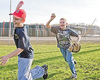 Geoffrey Hauschild|The Vindicator.Trent Stocker, 12 of Struthers, runs from Jacob Bova, 12, also of Struthers, during a game of Cheese Box outside the fields of Cene Park in Struthers on Wednesday afternoon
