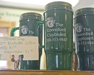Lisa-Ann Ishihara | The Vindicator ---- The Greenford Cupboard located on the corner of Route 165 and Lisbon Road travel cups
