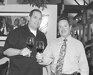 The Vindicator: Selecting wines for patrons to sample at a wine-tasting fundraiser to be sponsored by McDonald Lions Club on April 15 are, from left chef Leo DelGarbino and Carl Fossaceca, event coordinator.