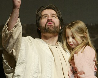 William D. Lewis|The Vindicator Jesus, portrayed by Bob Little of McDonald holds Kiersten Laing during Passion Play at Highway Tabernacle in Austintown.