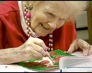 ROBERT K. YOSAY | THE VINDICATOR...Ruth Cooper works on a flower - Residents of Ashley Circle at Briarfield in Austintown paint with instruction from Suzanne Gray. Now they have a little gallery, called PicassoÕs Corner, at the facility, to display their work.-30-