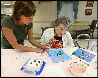 ROBERT K. YOSAY | THE VINDICATOR... Residents of Ashley Circle at Briarfield in Austintown paint with instruction from Suzanne Gray. Now they have a little gallery, called PicassoÕs Corner, at the facility, to display their work.-30-.