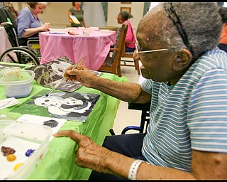 ROBERT K. YOSAY | THE VINDICATOR... Helen Bailey works on her pandas - Residents of Ashley Circle at Briarfield in Austintown paint with instruction from Suzanne Gray. Now they have a little gallery, called PicassoÕs Corner, at the facility, to display their work.-30-.